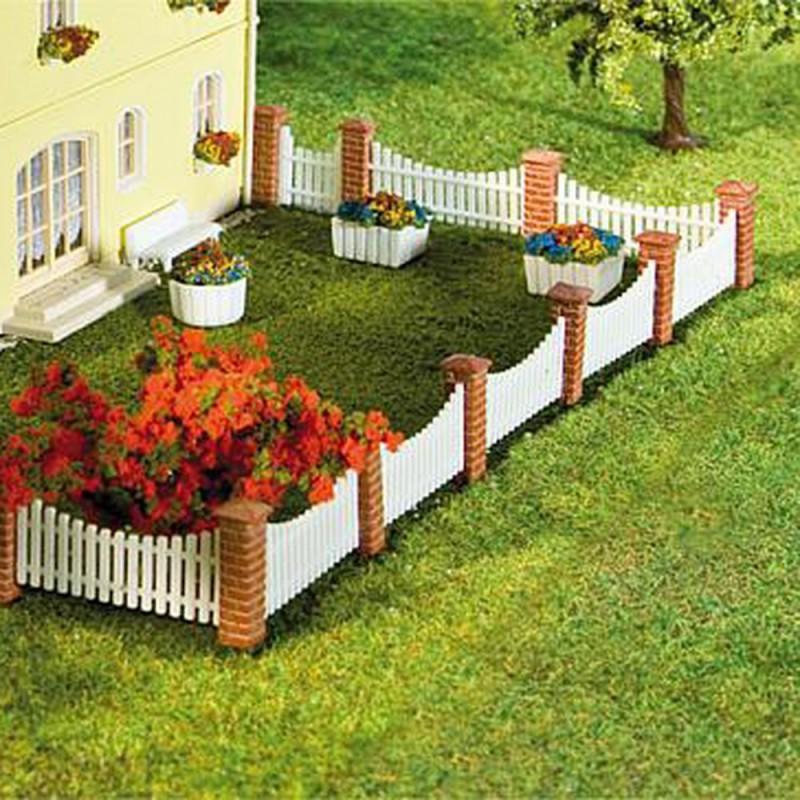 Cl ture de jardin poteaux briques lames ajour es n faller for Cloture de separation jardin